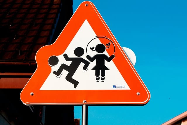 Safety sign of kids playing