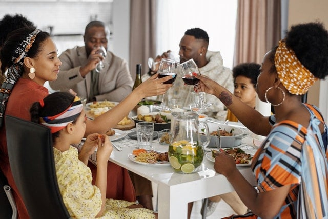 Extended family clinking glasses during Thanksgiving dinner